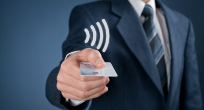 contactless card being handed to you by man in suit