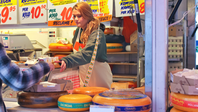 Dutch cheese stall woman being handed a card for payment