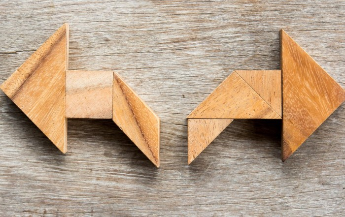 wooden arrows point left and right